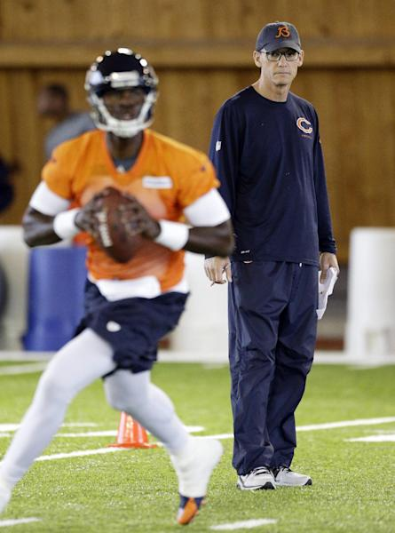 Chicago Bears head coach Marc Trestman, right, looks at quarterback Jerrod Johnson (4) during the team's NFL football rookie camp Friday, May 16, 2014, in Lake Forest, Ill. (AP Photo/Nam Y. Huh)