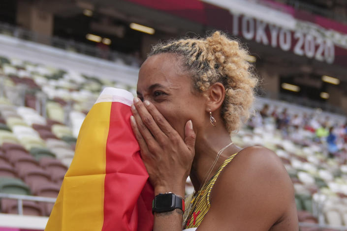 Malaika Mihambo, of Germany, celebrates after winning the gold medal in the women's long jump final at the 2020 Summer Olympics, Tuesday, Aug. 3, 2021, in Tokyo. (AP Photo/Matthias Schrader)