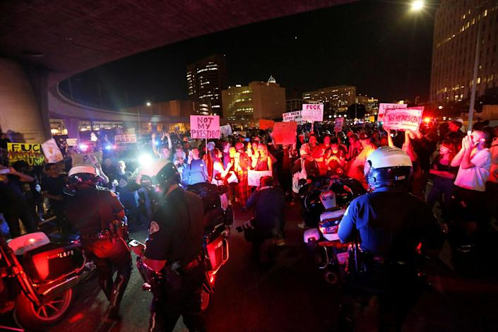 <p>Police are surrounded by demonstrators who took over the Hollywood 101 Freeway just north of Los Angeles City Hall in protest to the election of Republican Donald Trump as President of the United States in Los Angeles, Calif., Nov. 9, 2016. (Photo: Mario Anzuoni/Reuters) </p>