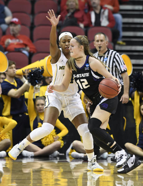 Kansas State guard Rachel Ranke (12) attempts to drive past the defense of Michigan guard Akienreh Johnson (14) during the first half of a first-round game in the NCAA women's college basketball tournament in Louisville, Ky., Friday, March 22, 2019. (AP Photo/Timothy D. Easley)