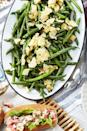 "<p>Even the kids will be eating their veggies thanks to this <a href=""https://www.countryliving.com/food-drinks/g1547/green-bean-recipes/"" rel=""nofollow noopener"" target=""_blank"" data-ylk=""slk:green bean"" class=""link rapid-noclick-resp"">green bean</a> platter. In fact, they might just even go in for seconds!</p><p><strong><a href=""https://www.countryliving.com/food-drinks/a27547118/green-beans-and-crushed-salt-and-vinegar-chips-recipe/"" rel=""nofollow noopener"" target=""_blank"" data-ylk=""slk:Get the recipe"" class=""link rapid-noclick-resp"">Get the recipe</a>.</strong></p>"