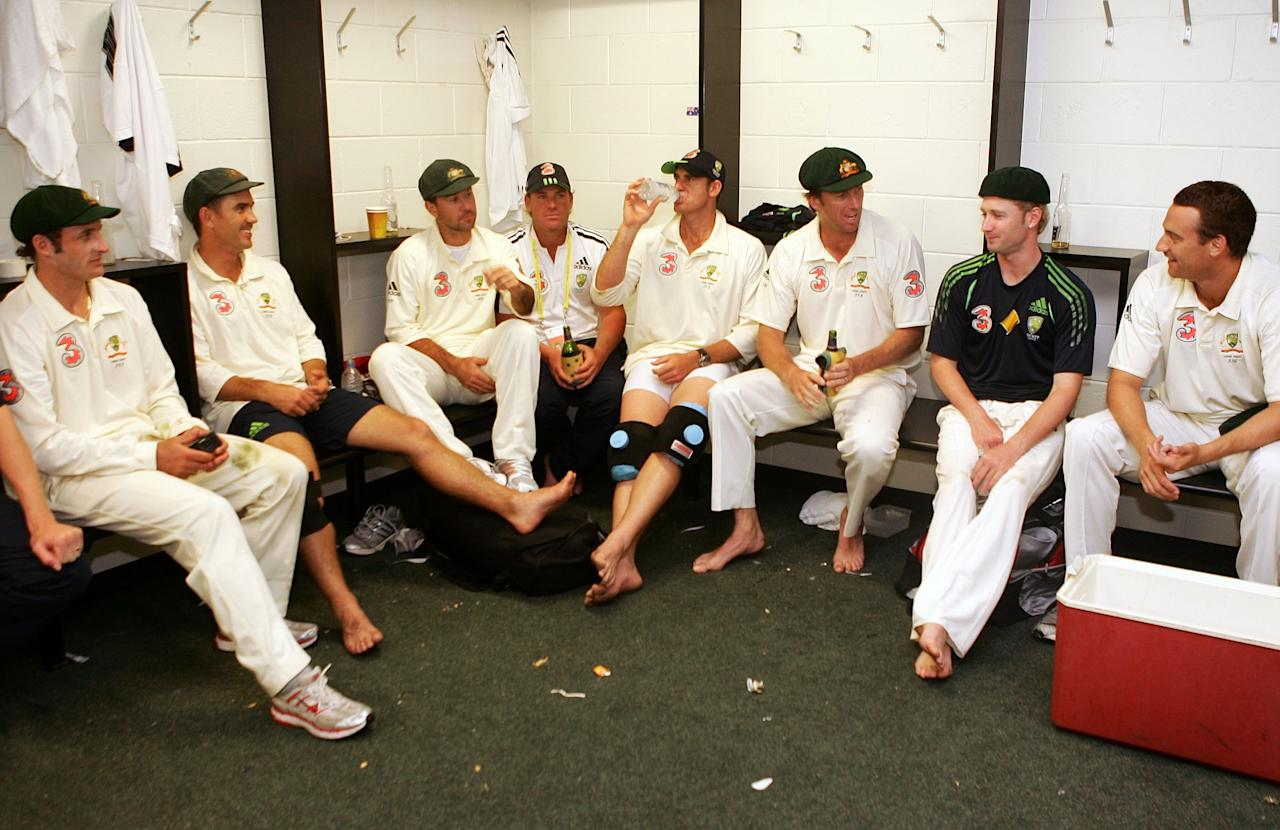 BRISBANE, AUSTRALIA - NOVEMBER 27:  (L-R) Mike Hussey, Justin Langer, Ricky Ponting, Shane Warne, Matthew Hayden, Glenn McGrath, Michael Clarke and Stuart Clark of Australia celebrate in the changing rooms after Australia's victory on day five of the first Ashes Test Match between Australia and England at The Gabba on November 27, 2006 in Brisbane, Australia.  (Photo by Hamish Blair/Getty Images)