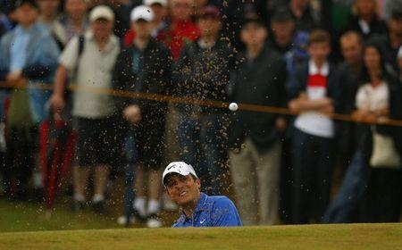 Francesco Molinari of Italy watches his shot from a bunker during the third round of the British Open Championship at the Royal Liverpool Golf Club in Hoylake