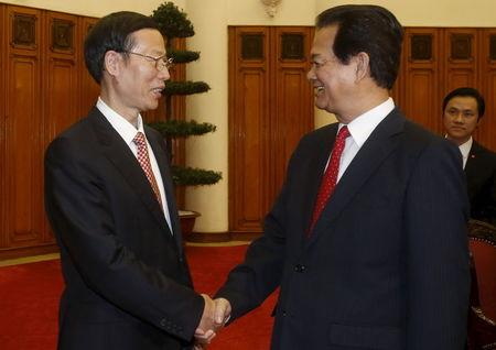 China's Vice Premier Zhang shakes hands with Vietnam's PM Dung before their meeting at the Government Office in Hanoi