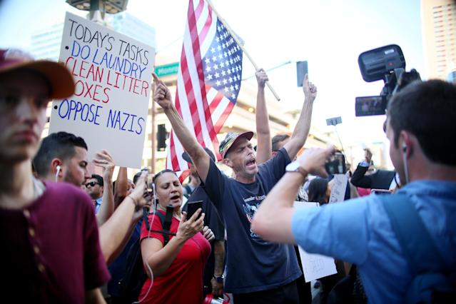 <p>Pro Trump supporters face off with peace activists during protests outside a Donald Trump campaign rally in Phoenix, Arizona, U.S. August 22, 2017. (Sandy Huffaker/Reuters) </p>
