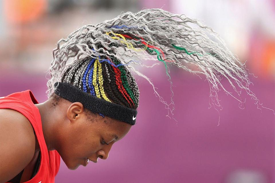 """<p>One of my favs so far? This braided ponytail with curly ends worn by Stephanie Mawuli from Team Japan's women's basketball. Mawuli <strong>showed <em>up</em> with this colorful-AF braided style</strong>, which gradually fades from the colors of the Olympic rings into a really cool <a href=""""https://www.cosmopolitan.com/style-beauty/beauty/g24514724/gray-hair-color-ideas/"""" rel=""""nofollow noopener"""" target=""""_blank"""" data-ylk=""""slk:silver hair color"""" class=""""link rapid-noclick-resp"""">silver hair color</a>.</p>"""