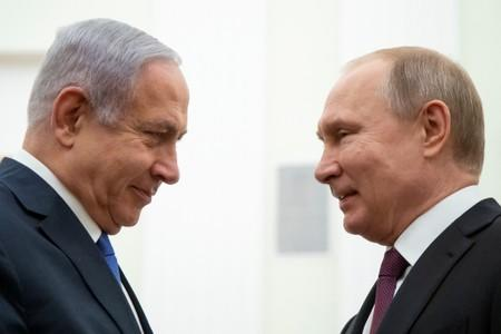 FILE PHOTO: Russian President Vladimir Putin and Israeli Prime Minister Benjamin Netanyahu greet each other during their meeting in the Kremlin in Moscow