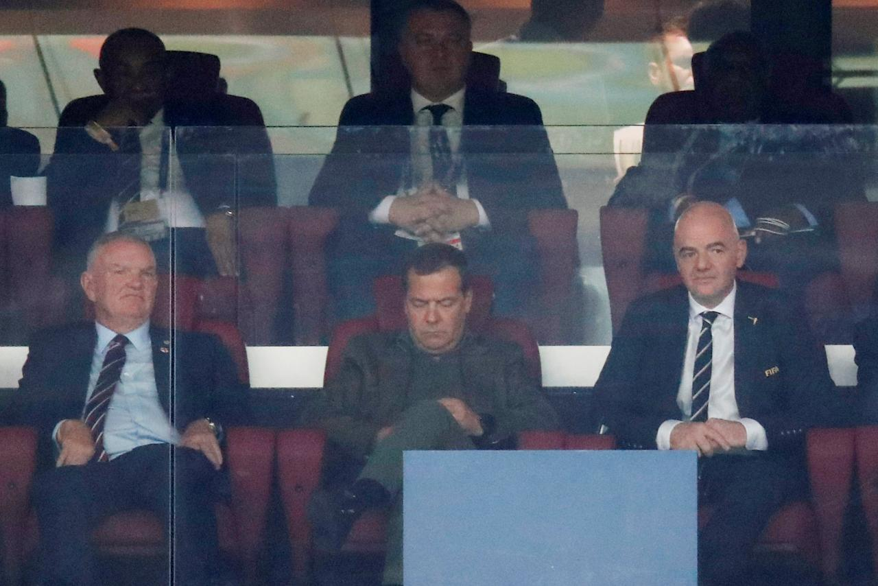 Soccer Football - World Cup - Semi Final - Croatia v England - Luzhniki Stadium, Moscow, Russia - July 11, 2018  Chairman of the Football Association Greg Clarke, Prime Minister of Russia Dmitry Medvedev and FIFA president Gianni Infantino during the match  REUTERS/Maxim Shemetov