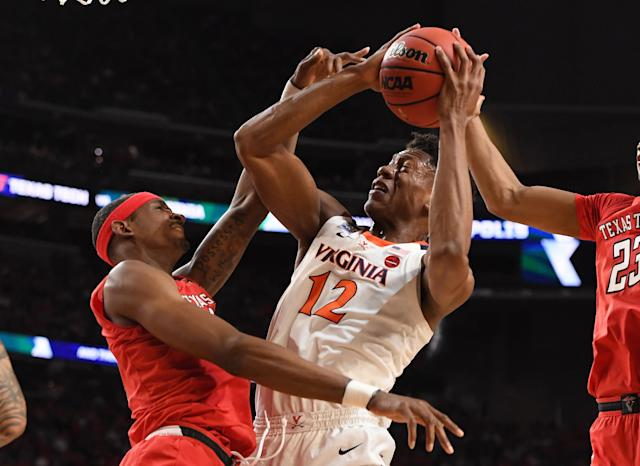 MINNEAPOLIS, MINNESOTA - APRIL 08: De'Andre Hunter #12 of the Virginia Cavaliers drives to the basket against Tariq Owens #11 of the Texas Tech Red Raiders in the 2019 NCAA men's Final Four National Championship game at U.S. Bank Stadium on April 08, 2019 in Minneapolis, Minnesota. (Photo by Brett Wilhelm/NCAA Photos via Getty Images)