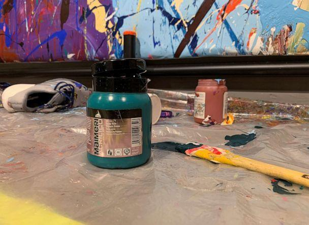 PHOTO: The paint pot and brush used by a young couple to paint over the graffiti artwork of New York-based artist Jon One is seen at a gallery in Seoul, South Korea April 2, 2021. (Minwoo Park/Reuters)