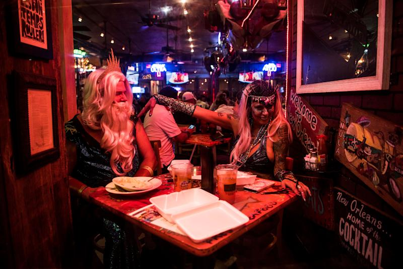 A costumed couple at a French Quarter restaurant is surprisingly not a surprising sight.
