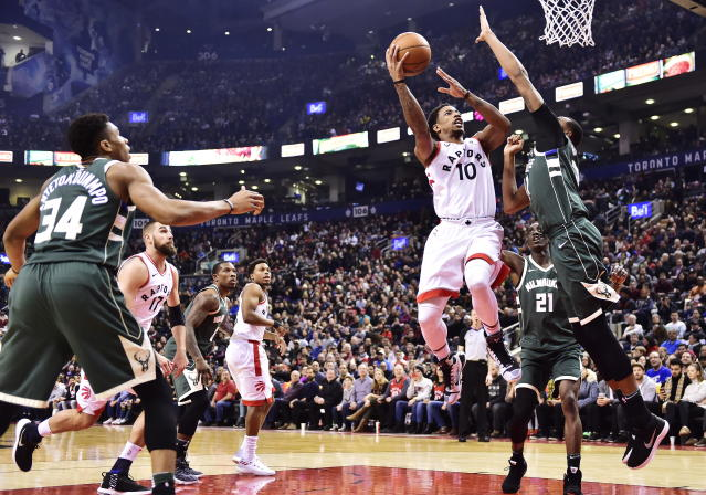 "<a class=""link rapid-noclick-resp"" href=""/nba/teams/tor/"" data-ylk=""slk:Toronto Raptors"">Toronto Raptors</a> guard <a class=""link rapid-noclick-resp"" href=""/olympics/rio-2016/a/1128527/"" data-ylk=""slk:DeMar DeRozan"">DeMar DeRozan</a> (10) shoots over <a class=""link rapid-noclick-resp"" href=""/nba/teams/mil/"" data-ylk=""slk:Milwaukee Bucks"">Milwaukee Bucks</a> forward <a class=""link rapid-noclick-resp"" href=""/nba/players/5020/"" data-ylk=""slk:John Henson"">John Henson</a> (31) during first half NBA basketball action in Toronto on Monday, Jan. 1, 2018. (Frank Gunn/The Canadian Press via AP)"