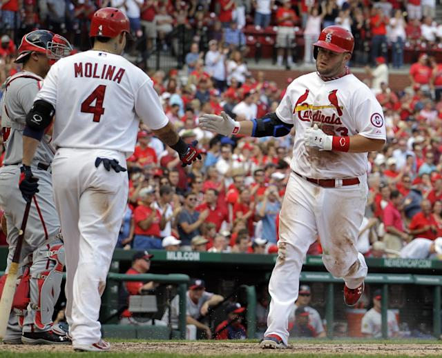 St. Louis Cardinals' Matt Adams, right, is congratulated by Yadier Molina after hitting a solo home run during the sixth inning of a baseball game against the Washington Nationals Wednesday, Sept. 25, 2013, in St. Louis. (AP Photo/Jeff Roberson)