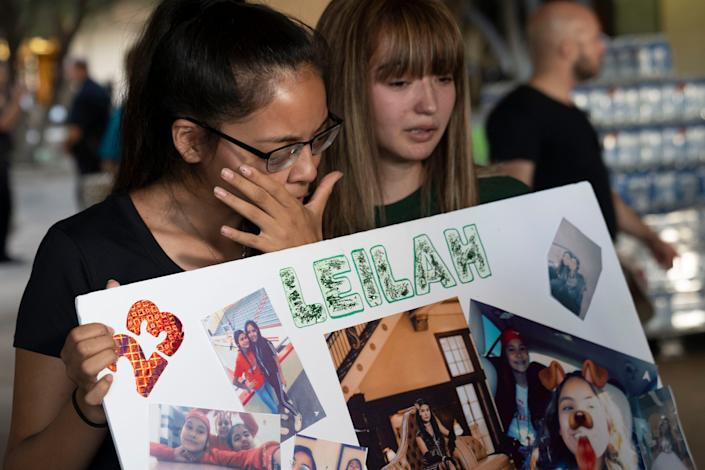 Yasmin Natera 16, left, and Celeste Lujan, 15, cries for one of their friends, a victim in a mass shooting in Odessa. The community came together at the University of Texas for a prayer vigil.