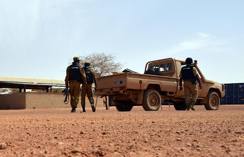 Burkina Faso soldiers patrol near Tambao mine on April 5, 2015, a day after five armed men attacked the manganese mine and kidnapped a Romanian worker (AFP Photo/Ahmed Ouoba)
