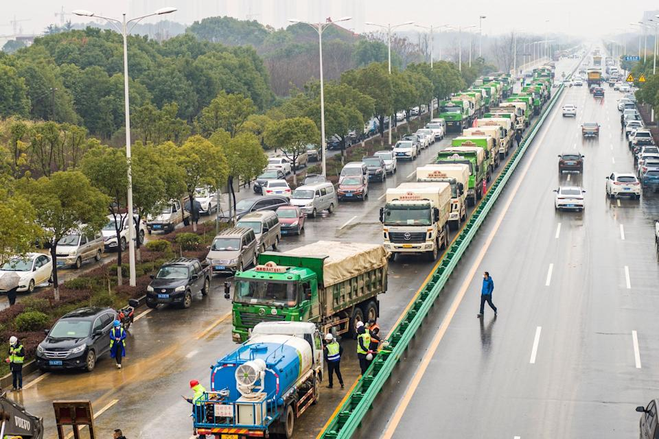 Trucks queueing to enter the construction site of a new hospital in Wuhan.