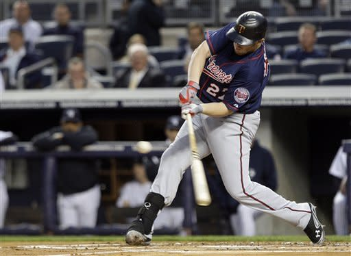 Minnesota Twins' Chris Parmelee hits a single during the first inning against the New York Yankees at Yankee Stadium in New York, Wednesday, April 18, 2012. (AP Photo/Frank Franklin II)