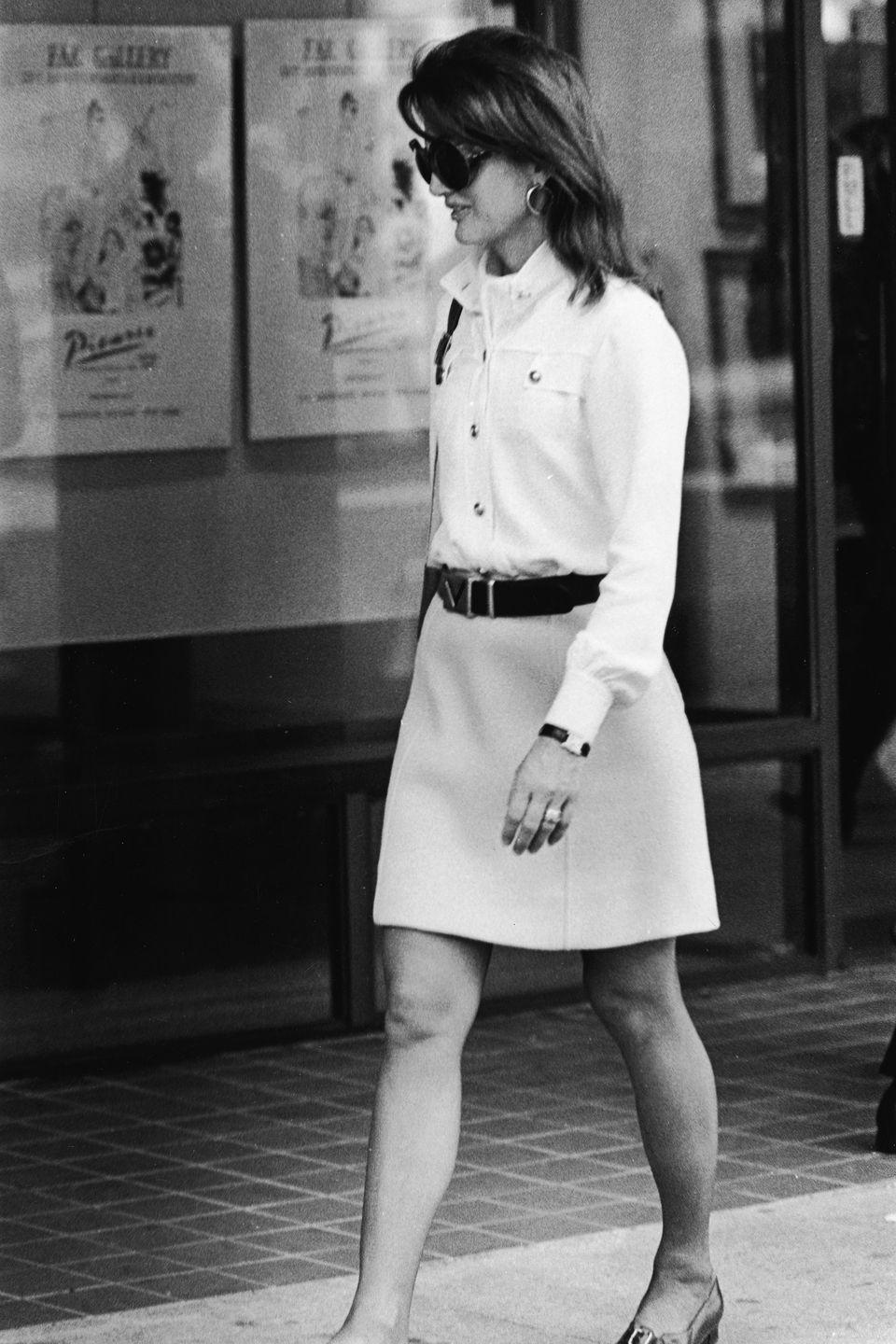 <p>It's always time for mini A-line skirts and smart jackets, as worn here walking along the sidewalk in NYC in 1970. This whole ensemble wouldn't look a bit out of place in 2019. </p>