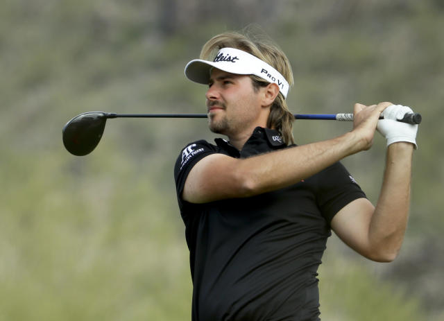Victor Dubuisson, of France, watches his tee shot on the 11th hole in his championship match against Jason Day, of Australia, during the Match Play Championship golf tournament on Sunday, Feb. 23, 2014, in Marana, Ariz. (AP Photo/Ted S. Warren)