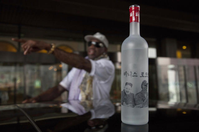 A bottle of vodka with handmade illustrations of Rodman with North Korean leader Kim Jong Un and Rodman's name in Korean sits on the roof of a car outside a Pyongyang hotel on Tuesday, Jan. 7, 2014. Rodman came to the North Korean capital with a team of USA basketball stars for an exhibition game on Jan. 8, the birthday of North Korean leader Kim Jong Un. (AP Photo/David Guttenfelder)