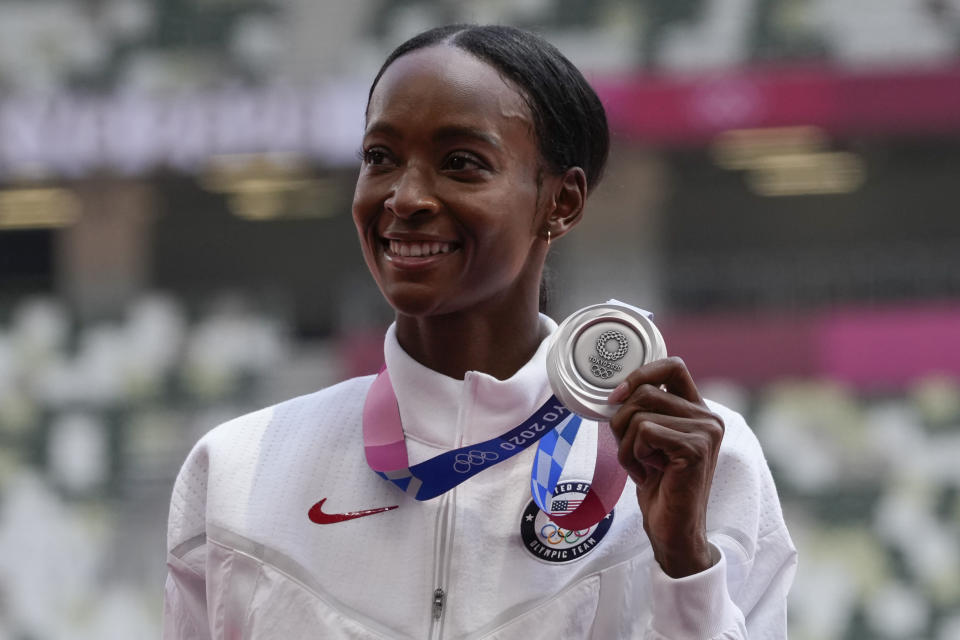 Silver medalist Dalilah Muhammad, of the United States, poses during the medal ceremony for the women's 400-meter hurdles at the 2020 Summer Olympics, Wednesday, Aug. 4, 2021, in Tokyo. (AP Photo/Francisco Seco)