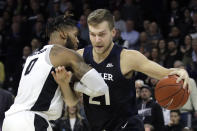 Butler center Derrik Smits (21) drives against Providence center Nate Watson (0) during the first half of an NCAA college basketball game Friday, Jan. 10, 2020, in Providence, R.I. (AP Photo/Elise Amendola)