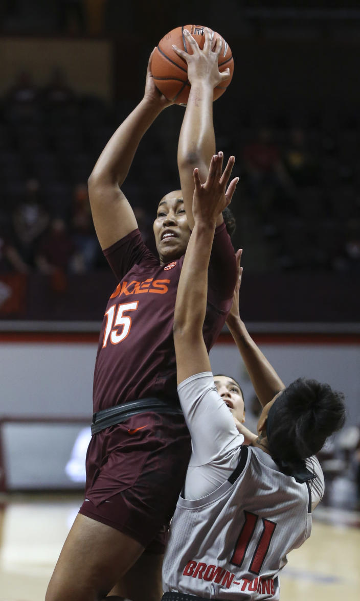 Virginia Tech's Azana Baines (15) grabs an offensive rebound in front of North Carolina State's Jakia Brown-Turner (11) during the first half of an NCAA college basketball game in Blacksburg, Va., Thursday, Jan. 28, 2021. (Matt Gentry/The Roanoke Times via AP, Pool)