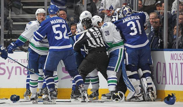 TORONTO, ON - NOVEMBER 5: Frederik Andersen #31 of the Toronto Maple Leafs leaves his crease to join in a fight against Ryan Miller #30 of the Vancouver Canucks during an NHL game at the Air Canada Centre on November 5, 2016 in Toronto, Ontario, Canada. The Leafs defeated the Canucks 6-3. (Photo by Claus Andersen/Getty Images)