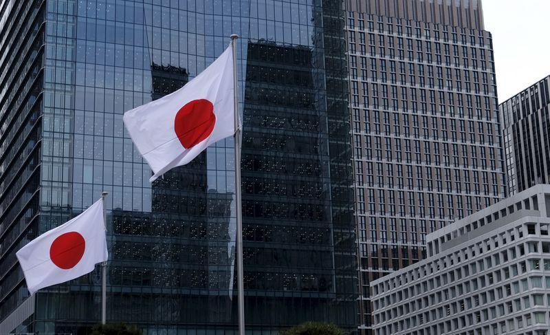 Japan govt. to keep view economy recovering despite virus risk - sources