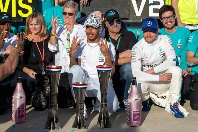 Lewis Hamilton is now only one world title short of Michael Schumacher's record (AFP Photo/SUZANNE CORDEIRO)