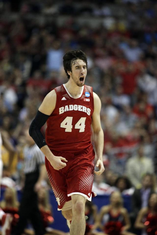 Wisconsin 's Frank Kaminsky reacts after making a shot during the first half in a regional final NCAA college basketball tournament game against Arizona, Saturday, March 29, 2014, in Anaheim, Calif. (AP Photo/Alex Gallardo)