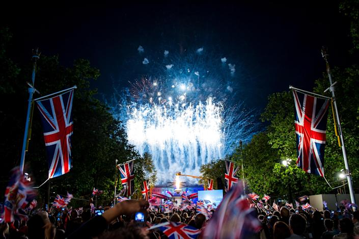 The crowds enjoy the fireworks over Buckingham Palace during the finale of the Diamond Jubilee Buckingham Palace Concert on June 4, 2012 in London, England. For only the second time in it's history, the UK celebrates the Diamond Jubilee of a monarch. Her Majesty Queen Elizabeth II celebrates the 60th anniversary of her ascension to the throne. (Photo by Ian Gavan/Getty Images)