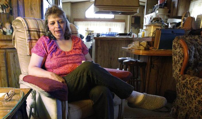 In this photo made on Tuesday, April 10, 2012, Janet McIntyre talks about the water from her well while sitting in her home in Evans City, Pa. McIntyre, whose home is near a gas well drilled using the hydraulic fracturing process, said doctors told her not to drink or bathe in the water after test results showed traces of chemicals. She lives in one of ten households in a neighborhood 30 miles north of Pittsburgh, where residents feel nearby drilling has impacted their water. State and industry experts say tests have shown the water is fine. (AP Photo/Keith Srakocic)