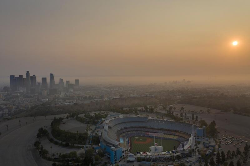Professionals have to recognize when it's no longer OK to push through work during a disaster. Above, the Los Angeles skyline and sunset is obscured by smoke, ash and smog on Sept. 14. (Photo: Allen J. Schaben via Getty Images)