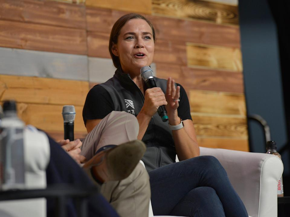 Natalie Coughlin today with a microphone in her hand sitting in a chair