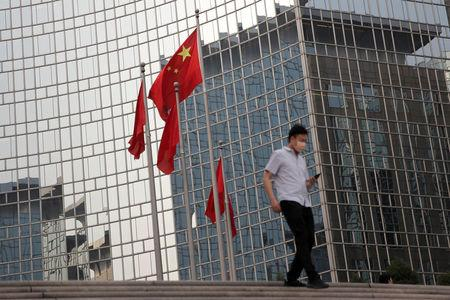 The Chinese national flag flies outside a hotel in central Beijing