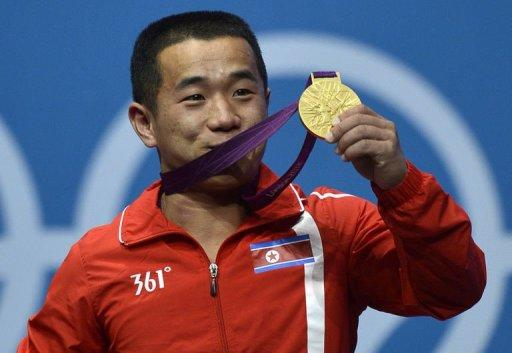 North Korea's Om Yun Chol celebrates with his gold medal