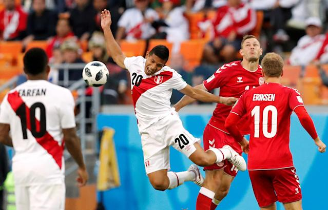 Soccer Football - World Cup - Group C - Peru vs Denmark - Mordovia Arena, Saransk, Russia - June 16, 2018 Peru's Edison Flores in action with Denmark's Henrik Dalsgaard REUTERS/Carlos Garcia Rawlins TPX IMAGES OF THE DAY