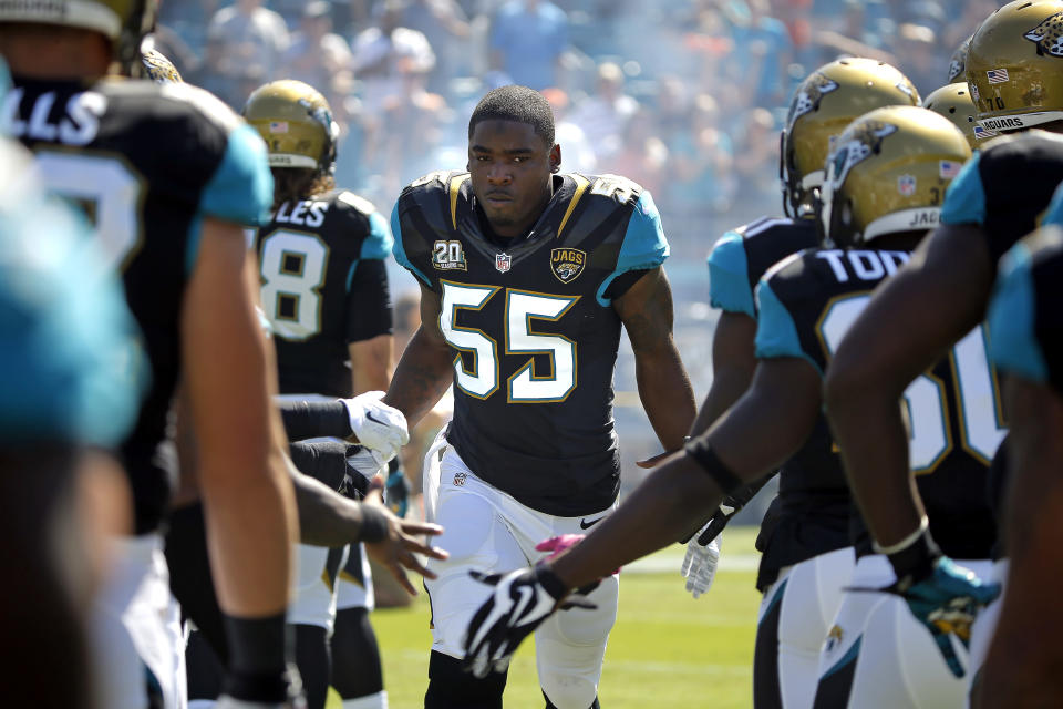 FILE - Jacksonville Jaguars outside linebacker Geno Hayes (55) runs onto EverBank Field before the start of an NFL football game against the Cleveland Browns in Jacksonville, Fla., in this Sunday, Oct. 19, 2014, file photo. Hayes, a former NFL linebacker who starred at Florida State, has died. He was 33. The Tampa Bay Buccaneers on Tuesday, April 27, 2021, confirmed his death. He had liver disease and had been in hospice care. (AP Photo/Stephen B. Morton, File)