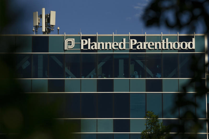 FILE - This April 19, 2019, file photo shows a Planned Parenthood building in Houston. A network of eight Christian pregnancy centers in Texas will provide contraceptive options next year as it vies for federal funding Planned Parenthood relinquished earlier this summer. The Source will take the unprecedented step of offering women pills, injections, and intrauterine devices while the organization looks to build an additional 20 clinics across Texas. The Source Chief Executive Andy Schoonover says the organization is focused on being proactive in reducing unplanned pregnancies.(Godofredo A Vasquez/Houston Chronicle via AP, File)