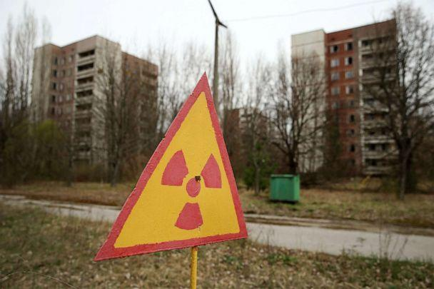 PHOTO: A sign warns of radiation contamination near former apartment buildings in Pripyat, Ukraine, April 9, 2016. (Sean Gallup/Getty Images, FILE)