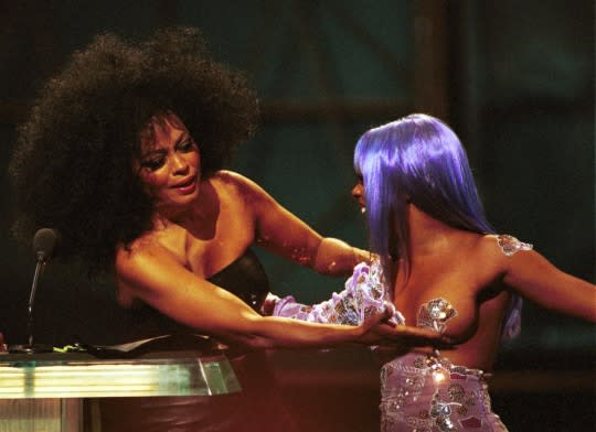 <p>When Motown legend Diana met queen bee Kim (when they presented an award together with Mary J. Blige), a simple handshake just wouldn't do. Dirty Diana instead took a very hands-on approach, and enthusiastically jiggled Kim's purple-pastie'd left bosom onstage. Talk about a boob-tube moment! (Source: Yahoo Music) </p>