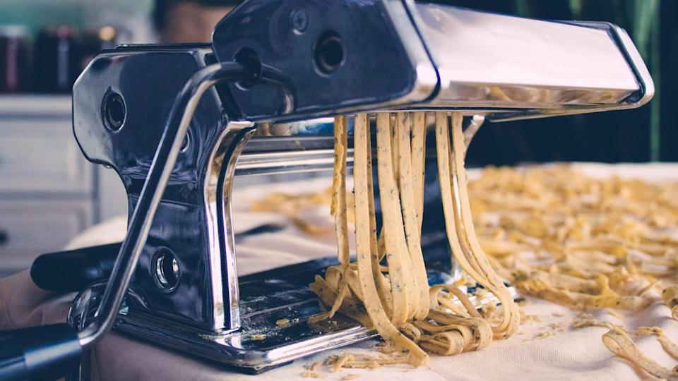Fresh homemade Fettuccine, pasta  on the kitchen table, selective focus.