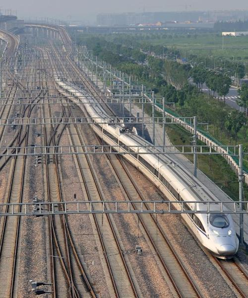 A high-speed train departs from the Shanghai Hongqiao railway station, eastern China, on August 21, 2011