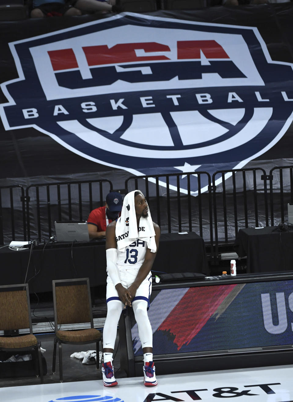 United States' Bam Adebayo (13) looks on from the sideline during an exhibition basketball game against Nigeria, Saturday, July 10, 2021, in Las Vegas. (AP Photo/David Becker)