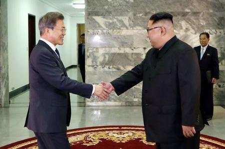 FILE PHOTO: South Korean President Moon Jae-in is greeted by North Korean leader Kim Jong Un during their summit at the truce village of Panmunjom