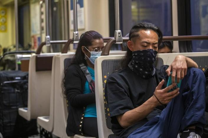 LOS ANGELES, CA - JUNE 02: Kazuki Orita is wearing a face mask on the Metro due to the coronavirus pandemic on Wednesday, June 2, 2021 in Los Angeles, CA. (Francine Orr / Los Angeles Times)