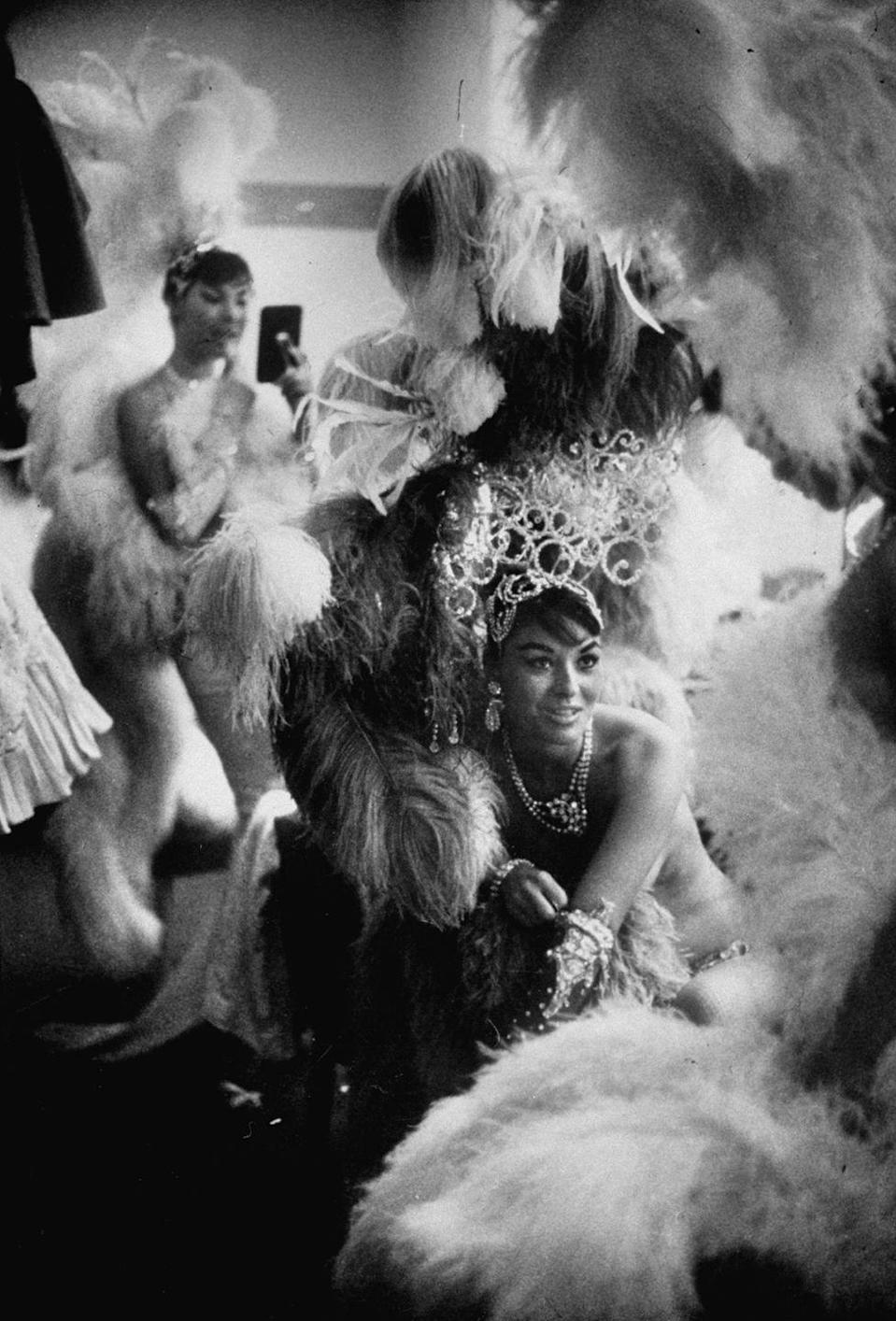 "<p>Showgirls in the dressing room of the Stardust Hotel in 1958. From 1959 to 1964, the hotel's convention center was reserved for ""high roller"" guests and The Stardust showgirls.</p>"