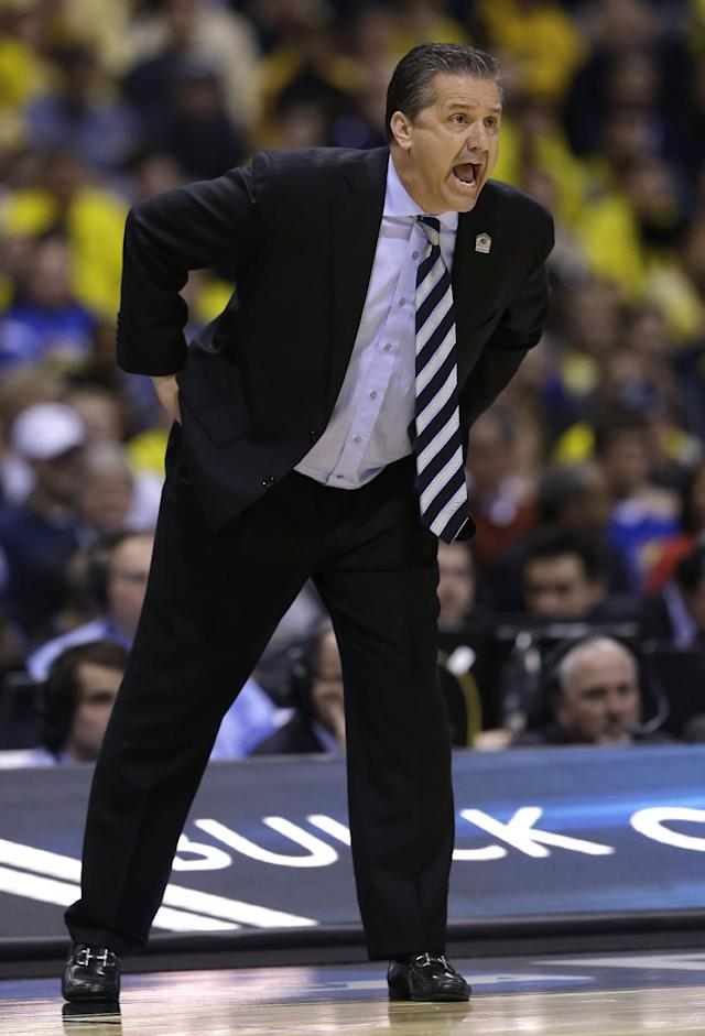 Kentucky head coach John Calipari yells to his players during the first half of an NCAA Midwest Regional final college basketball tournament game against Michigan Sunday, March 30, 2014, in Indianapolis. (AP Photo/David J. Phillip)