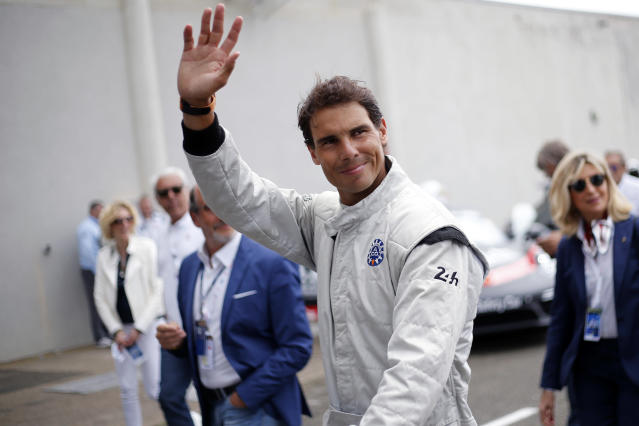 Spain's Rafael Nadal waves to supporters prior to the start of the 86th 24-hour Le Mans endurance race, in Le Mans, western France, Saturday, June 16, 2018. (AP Photo/Thibault Camus)